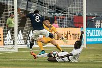 FOXBOROUGH, MA - JULY 27:  Lamine Sane #22 slides to intercept a shot on goal at Gillette Stadium on July 27, 2019 in Foxborough, Massachusetts.