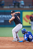 Fresno Grizzles second baseman Nolan Fontana (9) throws to first as Darnell Sweeney (9) slides into second during a game against the Oklahoma City Dodgers on June 1, 2015 at Chickasaw Bricktown Ballpark in Oklahoma City, Oklahoma.  Fresno defeated Oklahoma City 14-1.  (Mike Janes/Four Seam Images)