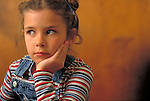 portrait of serious young girl waiting impatiently at doctor's office