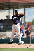New York Yankees relief pitcher Domingo Acevedo (86) looks in for the sign during a Grapefruit League Spring Training game against the Detroit Tigers on February 27, 2019 at Publix Field at Joker Marchant Stadium in Lakeland, Florida.  Yankees defeated the Tigers 10-4 as the game was called after the sixth inning due to rain.  (Mike Janes/Four Seam Images)