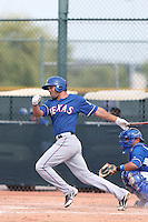 Zach Cone #15 of the Texas Rangers bats during a Minor League Spring Training Game against the Kansas City Royals at the Kansas City Royals Spring Training Complex on March 20, 2014 in Surprise, Arizona. (Larry Goren/Four Seam Images)