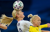 SOLNA, SWEDEN - APRIL 10: Lindsey Horan #9 of the United States heads a ball during a game between Sweden and USWNT at Friends Arena on April 10, 2021 in Solna, Sweden.