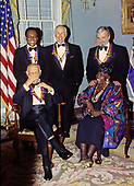 """The recipients of the 16th Annual Kennedy Center Honors pose for a group photo following a dinner at the United States Department of State in Washington, D.C. on Saturday, December 4, 1993.  Back row, from left to right: Arthur Mitchell, founder of the Dance Theatre of Harlem; former """"Tonight Show"""" host Johnny Carson; and composer and lyricist Stephen Sondheim. Front row, from left to right: conductor Georg Solti and gospel singer Marion Williams.  The 1993 honorees are: Johnny Carson, Arthur Mitchell, Georg Solti Stephen Sondheim and Marion Williams.<br /> Credit: Greg E. Mathieson / Pool via CNP"""