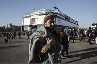 Pictured: A male migrant arrives at the port Monday 22 February 2016<br /> Re: Thousands of migrants, most from Syria, have landed to the port of Pireaus, after crossing the border from Turkey to various islands like Lesvos and Kos in Greece.