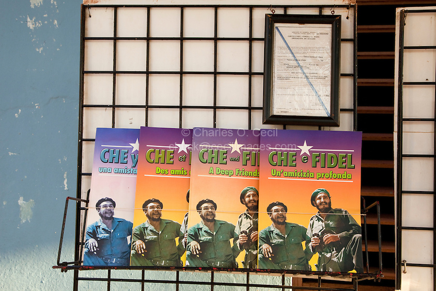 """Cuba.  """"Che and Fidel: a Deep Friendship"""" in English, Spanish, French, and Italian, on a book rack at a souvenir stand."""