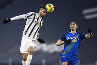 3rd January 2021, Allianz Stadium, Turin Piedmont, Italy; Serie A Football, Juventus versus Udinese;  Rodrigo Bentancur wins the header over Kevin Lasagna of Udinese