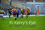 Kerry's Emma Dineen in possession as she out runs Aoife Cullen of Wexford in the Lidl LGFA National football league game in Fitzgerald Stadium Killarney on Sunday.