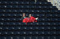 Two fans take in the NCAA baseball game between the Radford Highlanders and the Quinnipiac Bobcats at David F. Couch Ballpark on March 4, 2017 in Winston-Salem, North Carolina. The Highlanders defeated the Bobcats 4-0. (Brian Westerholt/Four Seam Images)