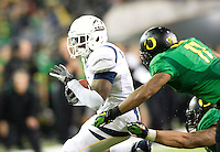 October 6th, 2011:  C.J. Anderson of California tries to rush away from Oregon defenders during a game at Autzen Stadium in Eugene, Oregon - Oregon defeated Cal 43 - 15