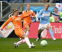 Chicago Red Stars forward Linsday Tarpley leaps to intercept a pass by Sky Blue FC midfielder Jen Buczkowski (4).  The Chicago Red Stars tied Sky Blue FC 0-0 at Toyota Park in Bridgeview, IL on April 19, 2009.