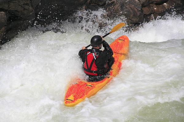 Man kayaking on Clear Creek west of Denver, Colorado, USA.