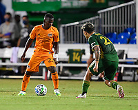 LAKE BUENA VISTA, FL - JULY 18: Darwin Quintero #23 of the Houston Dynamo is marked by Pablo Bonilla #28 of the Portland Timbers during a game between Houston Dynamo and Portland Timbers at ESPN Wide World of Sports on July 18, 2020 in Lake Buena Vista, Florida.