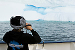 A young student records the icebergs off the coast of East Greenland. The student is part of the Cape Farewell Youth Expedition that was organized by the British Council of Canada.