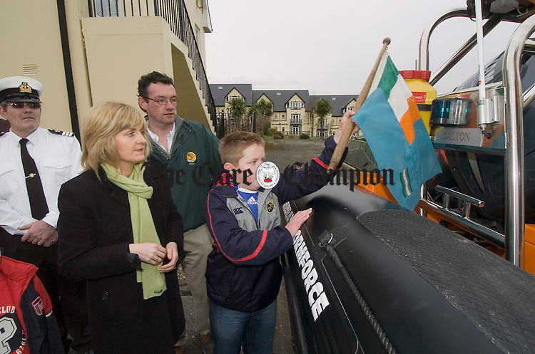 """Bridie Keogh, sister of the late Thomas Dalton and Shane Cleere, his nephew, unveil the name plate at the naming ceremony for the """"Dalton"""" the new Killaloe Ballina Search and Rescue boat. Looking on is Brendan Ryan. Photograph by John Kelly."""