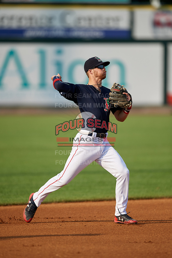 Lowell Spinners shortstop Korby Batesole (12) throws to first base during a game against the Vermont Lake Monsters on August 25, 2018 at Edward A. LeLacheur Park in Lowell, Massachusetts.  Vermont defeated Lowell 4-3.  (Mike Janes/Four Seam Images)
