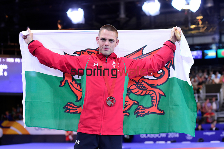 Men's FS 57kg medal ceremony.  Wales' Craig Pilling with his bronze medal and a Welsh flag.<br /> <br /> <br /> Photographer Chris Vaughan/Sportingwales<br /> <br /> 20th Commonwealth Games - Day 6 - Tuesday 29th July 2014 - Wrestling - SECC - Glasgow - UK