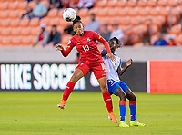HOUSTON, TX - FEBRUARY 3: Aldrith Quintero #10 of Panama heads the ball over Sherly Jeudy #9 of Haiti during a game between Panama and Haiti at BBVA Stadium on February 3, 2020 in Houston, Texas.