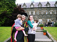 Doctor David Nott who received an honorary Doctorate degree, with his wife and two children. Monday 03 July 2017<br /> UWTSD Graduation ceremony at the University of Wales Trinity Saint Davids, Carmarthen Campus, Wales, UK