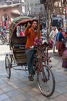 Nepal, Kathmandu.  Rickshaw Driver Looking for a Passenger.