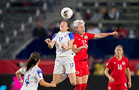 CARSON, CA - FEBRUARY 07: Maria Paula Salas #17 of Costa Rica battles in the air with Sophie Schmidt #13 of Canada during a game between Canada and Costa Rica at Dignity Health Sports Complex on February 07, 2020 in Carson, California.