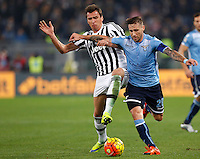 Calcio, Serie A: Lazio vs Juventus. Roma, stadio Olimpico, 4 dicembre 2015.<br /> Juventus' Mario Mandzukic, left, and Lazio's Lucas Biglia fight for the ball during the Italian Serie A football match between Lazio and Juventus at Rome's Olympic stadium, 4 December 2015.<br /> UPDATE IMAGES PRESS/Riccardo De Luca
