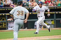 Round Rock Express outfielder Jim Adduci (24) runs home to score a run during the Pacific Coast League baseball game against the Salt Lake Bees on August 10, 2013 at the Dell Diamond in Round Rock, Texas. Round Rock defeated Salt Lake 9-6. (Andrew Woolley/Four Seam Images)
