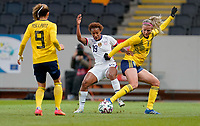 SOLNA, SWEDEN - APRIL 10: Crystal Dunn #19 of the United States battles for a ball during a game between Sweden and USWNT at Friends Arena on April 10, 2021 in Solna, Sweden.
