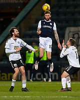 16th March 2021; Dens Park, Dundee, Scotland; Scottish Championship Football, Dundee FC versus Ayr United; Christie Elliott of Dundee heads clear from Joe Chalmers and Luke McCowan of Ayr United