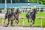 HALLANDALE BEACH, FLORIDA - APRIL 2:  Valid #5, ridden by Jockey Nik Juarez, coming around the final turn in the lead ahead of Team Colors #1, ridden by Jockey John Velazquez and Savory Stomp #6, ridden by Jockey Javier Castellano, and eventually wins the 34th Running of The Skip Away at Gulfstream Park on April 2, 2016 in Hallandale Beach, Florida (photo by Douglas DeFelice/Eclipse Sportswire/Getty Images)