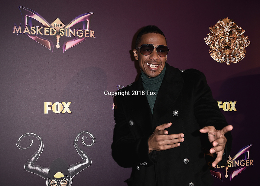 """WEST HOLLYWOOD - DECEMBER 13:  Nick Cannon at the premiere karaoke event for season one of """"The Masked Singer"""" at The Peppermint Club on December 13, 2018 in West Hollywood, California. (Photo by Scott Kirkland/Fox/PictureGroup)"""