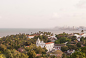 Olinda, Pernambuco State, Brazil. View of Recife from the top with Carmo church (igreja) and bay below.