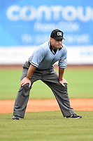 Field umpire Mike Cascioppo during a game between the Corpus Christi Hooks and NW Arkansas Naturals on May 26, 2014 at Arvest Ballpark in Springdale, Arkansas.  NW Arkansas defeated Corpus Christi 5-3.  (Mike Janes/Four Seam Images)