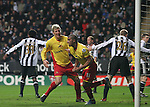 Newcastle United 2 Watford 1, 16/12/2006. St James Park, Premier League. Newcastle United take on Watford (yellow shirts) in a Premiership match at St. James' Park, Newcastle. Both teams were struggling near the bottom of the table with the newly-promoted visitors occupying one of the three relegation at the time of the match. Newcastle won by 2 goals to 1, both being scored by Obafemi Martins. Hameur Bouazza had equalised before United's late winner. Photo shows Hameur Boazza (third right) <br /> celebrating his goal for Watford. Photo by Colin McPherson.