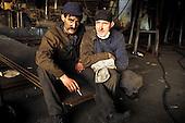 Gdansk, Poland. Two tired shipyard workers taking a cigarette break.