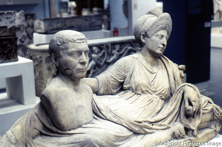 Greek Art:  Funerary Monument--Woman reclining on mattress, portrait bust of husband. Early 2nd Century A.D.  Rome.