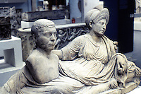 Greek Art:  Funerary Monument--Woman reclining on mattress, portrait bust of husband. Early 2nd Century A.D.  Rome.