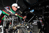 Feb. 9, 2012; Pomona, CA, USA; NHRA funny car driver John Force (left) talks with daughter Courtney Force as she sits strapped into the car during qualifying at the Winternationals at Auto Club Raceway at Pomona. Mandatory Credit: Mark J. Rebilas-