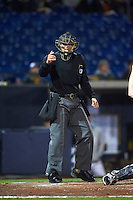 Umpire Richard Genera during the second game of a doubleheader between the Wisconsin Timber Rattlers and Quad Cities River Bandits on August 19, 2015 at Modern Woodmen Park in Davenport, Iowa.  Quad Cities defeated Wisconsin 8-1.  (Mike Janes/Four Seam Images)