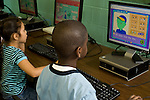 Elementary school Grade 2 male and female students using computers