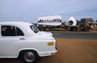 INDIA, Tamil Nadu, Kanyakumari, Cape Comorin, Muppandal, HM Ambassador car and transport of power house for Vestas RRB wind turbine to construction site, Vestas RRB is an indian danish joint venture / INDIEN Kanniyakumari, Kap Komorin, HM Ambassador Automobil und Transport eines Vestas Turbinenhauses zur Baustelle einer Windkraftanlage