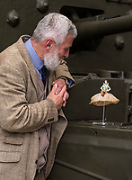BNPS.co.uk (01202) 558833<br /> Pic: TankMuseum/BNPS<br /> <br /> David Willey, curator of The Tank Museum, and Little Audrey - the story of the doll has been a hit at the new exhibition<br /> <br /> <br /> A delicate china doll that served as the lucky mascot for a British tank crew and miraculously survived the war in one piece has been unearthed by a museum. <br /> <br /> The small doll, called Little Audrey, had been given to Lionel 'Bill' Bellamy by his then girlfriend Audrey before he set out for Normandy in 1944. with the Royal Armoured Corps.<br /> <br /> She was adopted by the troop and was attached to Bellamy's Cromwell tank's searchlight to the right of the turret and she became a good luck charm – and they needed her.<br /> <br /> Little Audrey remained with the men as they fought through France, Belgium, Holland and Germany. She is now going on display at the Tank Museum at Bovington, Dorset.