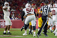 LOS ANGELES, CA - SEPTEMBER 11: Thomas Booker #4 of the Stanford Cardinal reacts to a tackle by Dalyn Wade-Perry #50 during a game between University of Southern California and Stanford Football at Los Angeles Memorial Coliseum on September 11, 2021 in Los Angeles, California.