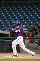Smerling Lantigua #1 of the AZL Rangers bats against the AZL Cubs at Surprise Stadium on July 6, 2014 in Surprise, Arizona. AZL Rangers defeated the AZL Cubs, 7-5. (Larry Goren/Four Seam Images)