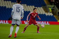 Wednesday 4th  December 2013 Pictured: ( l-r ) Marios Antoniades of Cyprus looks on as Gareth Bale moves the ball forwards for wales <br /> Re: UEFA European Championship Wales v Cyprus at the Cardiff City Stadium, Cardiff, Wales, UK