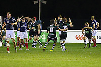 Dan Mugford of Nottingham Rugby (10 green) celebrates scoring a last minute drop goal to win the game during the Greene King IPA Championship match between London Scottish Football Club and Nottingham Rugby at Richmond Athletic Ground, Richmond, United Kingdom on 16 October 2015. Photo by David Horn.