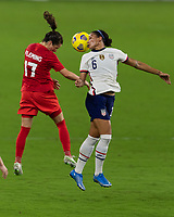 ORLANDO CITY, FL - FEBRUARY 18: Jessie Fleming #17 and Lynn Williams #6 battle for a header during a game between Canada and USWNT at Exploria stadium on February 18, 2021 in Orlando City, Florida.