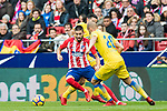 Yannick Ferreira Carrasco (L) of Atletico de Madrid competes for the ball with Alejandro Galvez Jimena (R) and David Simon of UD Las Palmas during the La Liga 2017-18 match between Atletico de Madrid and UD Las Palmas at Wanda Metropolitano on January 28 2018 in Madrid, Spain. Photo by Diego Souto / Power Sport Images