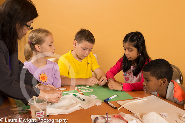 Education elementary science activity 4th grade students ages 9-10 with female teacher