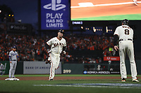 SAN FRANCISCO, CA - OCTOBER 8:  Buster Posey #28 of the San Francisco Giants hits a home run against the Los Angeles Dodgers during Game 1 of the NLDS at Oracle Park on Friday, October 8, 2021 in San Francisco, California. (Photo by Brad Mangin)