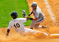 15 July 2010: Vermont Lake Monsters' infielder Hendry Jimenez slides safely into third during a game against the Aberdeen IronBirds at Centennial Field in Burlington, Vermont. The Lake Monsters rallied in the bottom of the 9th inning to defeat the IronBirds 7-6 notching their league leading 20th win of the 2010 NY Penn League season. Mandatory Credit: Ed Wolfstein Photo